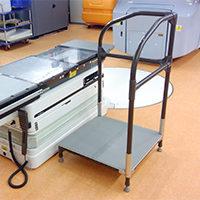 診療台への移乗による技師の負担を減らしたい